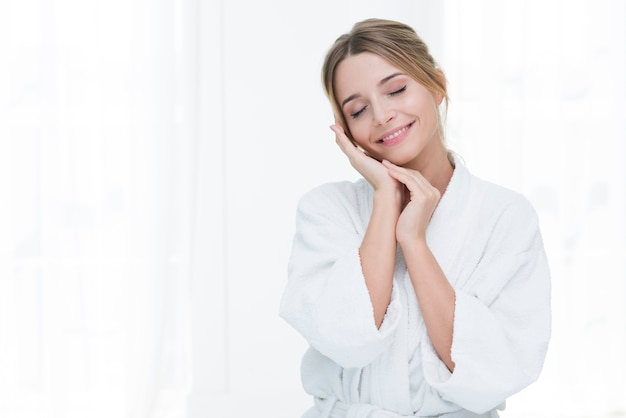 Woman posing with bathrobe in a spa