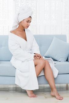 Woman posing with bathrobe in a spa