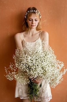 Woman posing with bouquet of beautiful flowers