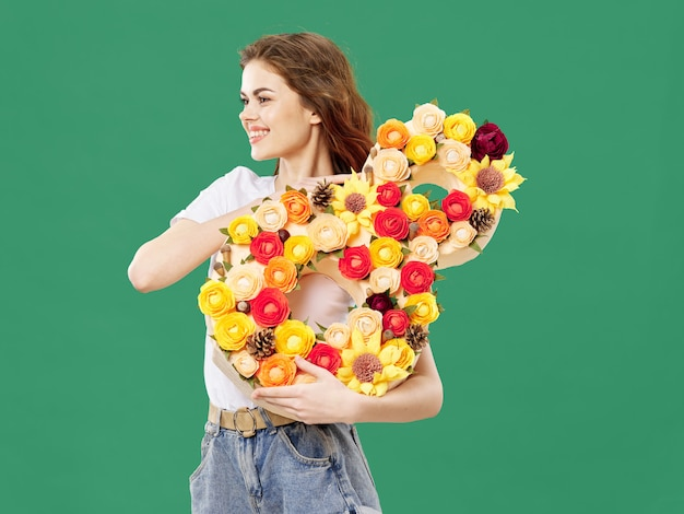 Woman posing with a bouquet of flowers, march 8, women's day