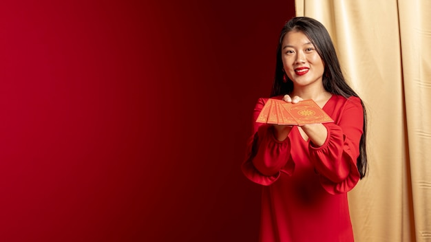 Woman posing with chinese new year cards