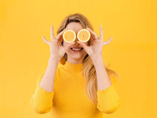 Woman posing with citrus