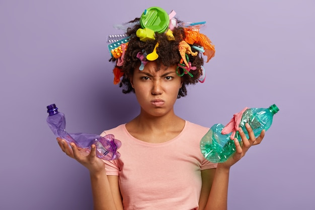 Woman posing with garbage in her hair