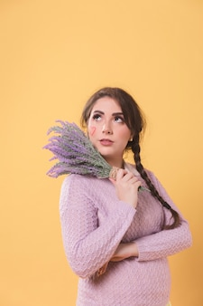 Woman posing with lavender and copy space