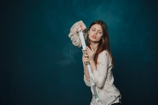 Woman posing with mop. cleaning concept