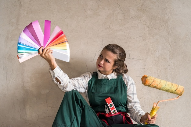 Woman posing with roller and colour swatch