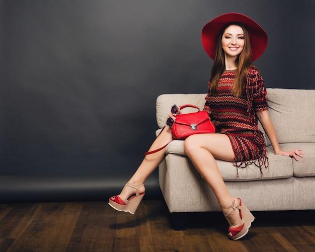 Woman posing with stylish footwear summer fashion and bag