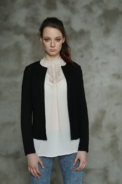 Woman posing with white blouse