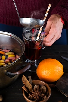 Woman pouring hot mulled wine