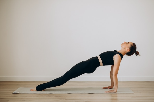 Woman practice pilates at yoga gym