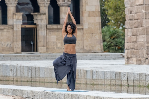 Woman practices yoga outdoor