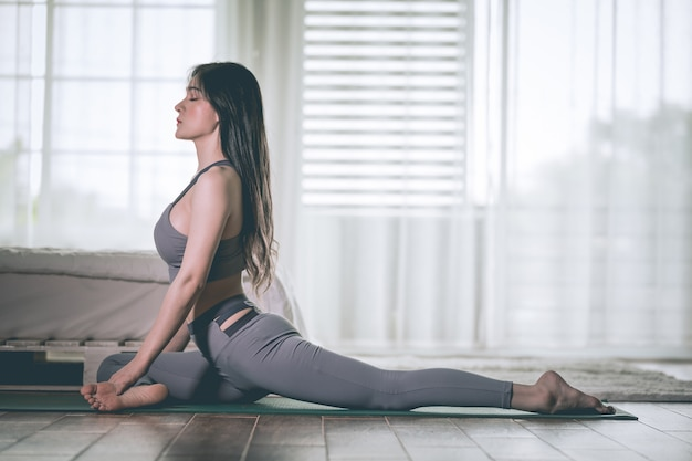 Woman practices yoga position