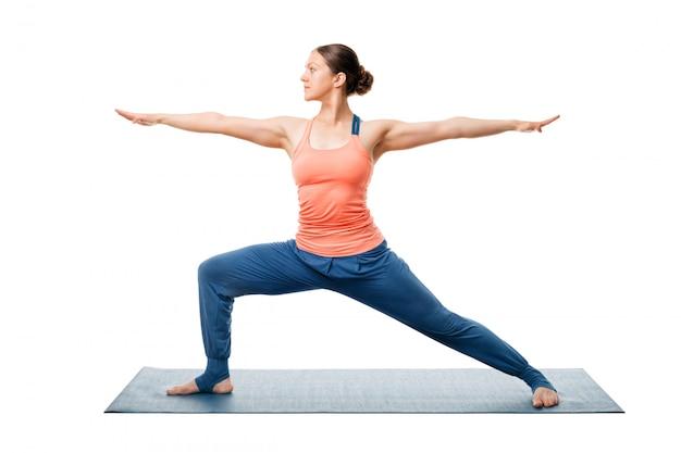 Woman practices yoga warrior asana