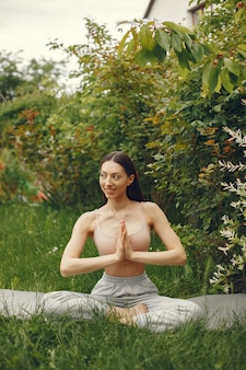 Woman practicing advanced yoga in a park