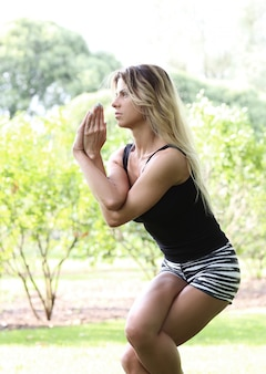 Woman practicing yoga outdoors