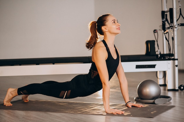 Woman practicing yoga and pilates