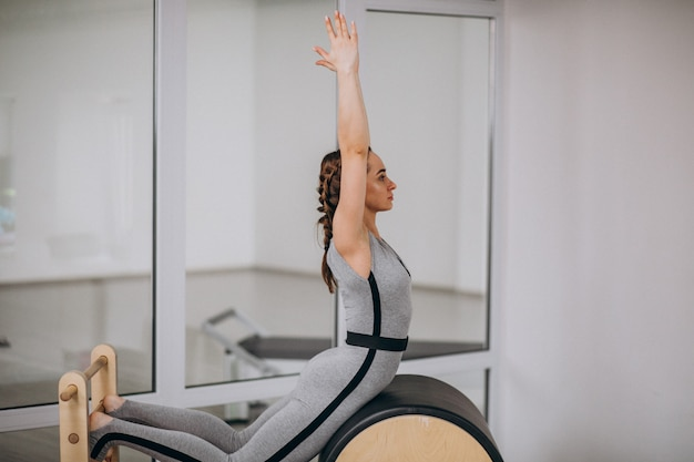 Woman practising yoga with equipment
