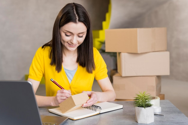 Woman preparing boxes for shipment