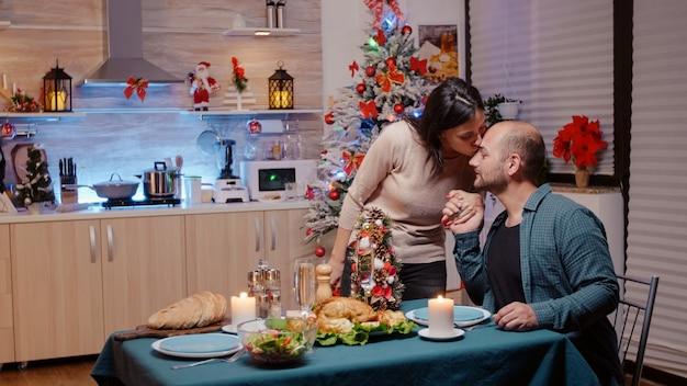 Woman preparing christmas dinner for celebration