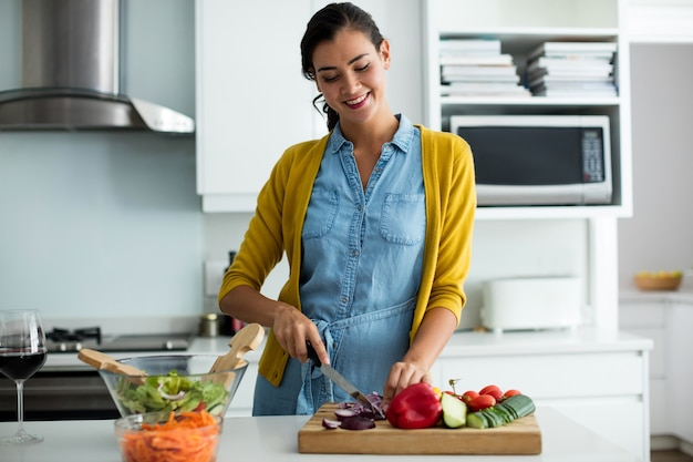 Woman preparing food in the kitchen at home