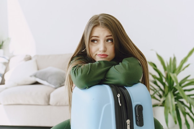 Woman preparing travel suitcase at home