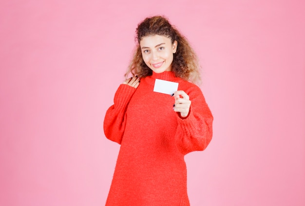 Woman presenting her business card or received other persons.