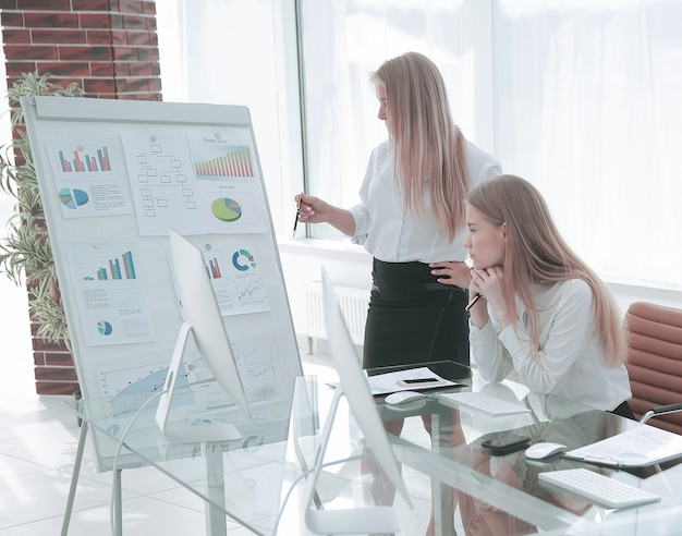 Woman presenting her idea to colleagues at meeting concept of teamwork