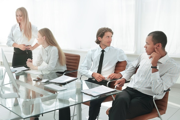 Woman presenting her idea to colleagues at meeting.