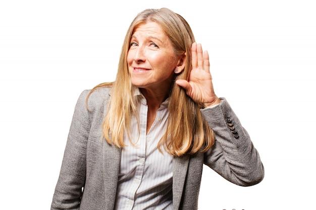 Woman pretending not to listen