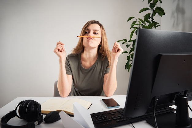 Woman procrastinate at home workplace remote work and home office problem