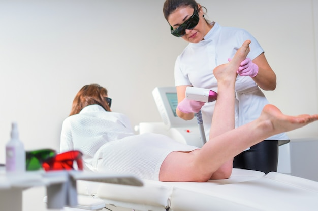 Woman in professional beauty clinic during laser hair removal. epilation treatment. smooth skin concept