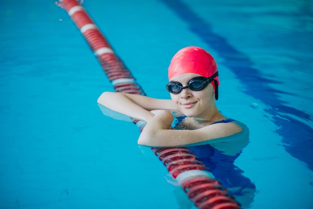 Woman professional swimmer in swimming pool