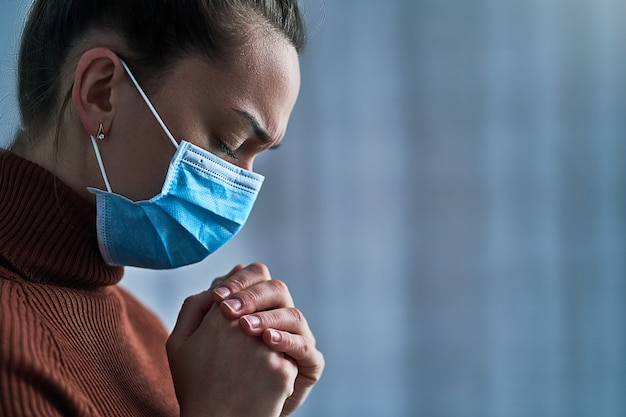 Premium Photo   Woman in protective mask with closed eyes and prayinghands, asks god for healing and recovery during illness