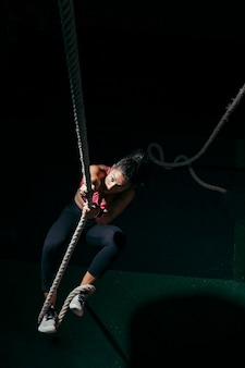 Woman pulling on rope