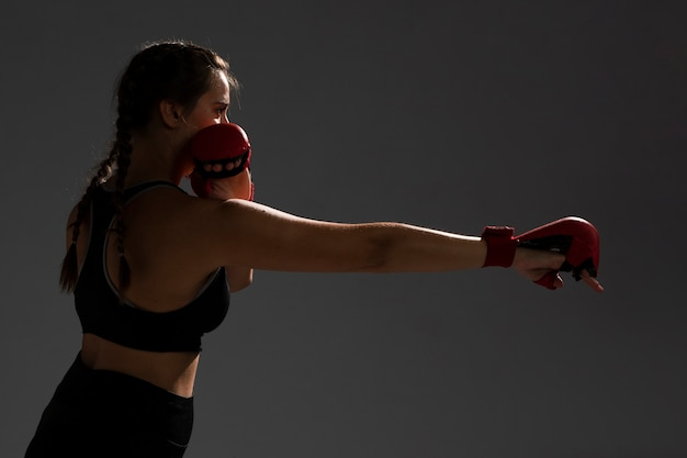 Woman punching with box gloves