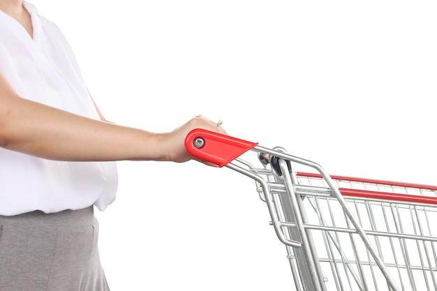 白い背景で隔離の女性プッシュショッピングカート