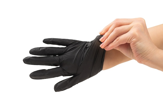 Woman puts on black rubber gloves isolated