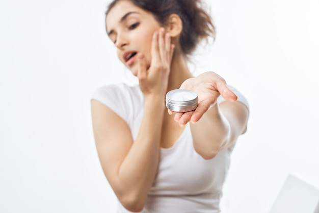 Woman putting on cream