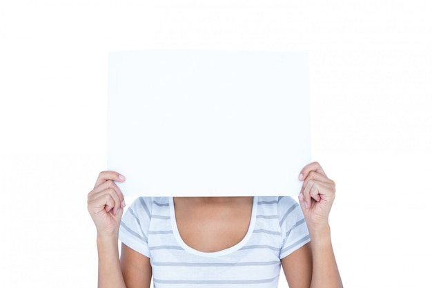 Woman putting paper over her faces