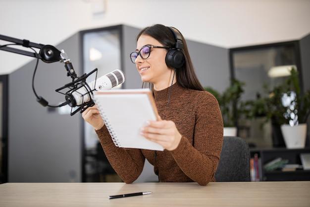 Woman in a radio studio broadcasting