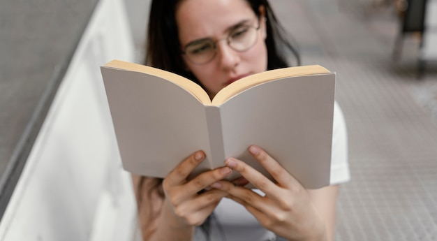 Woman reading a book alone
