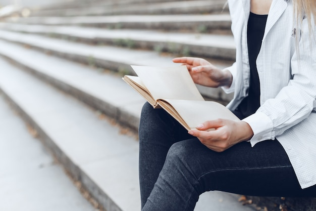 Woman reading book. close up.