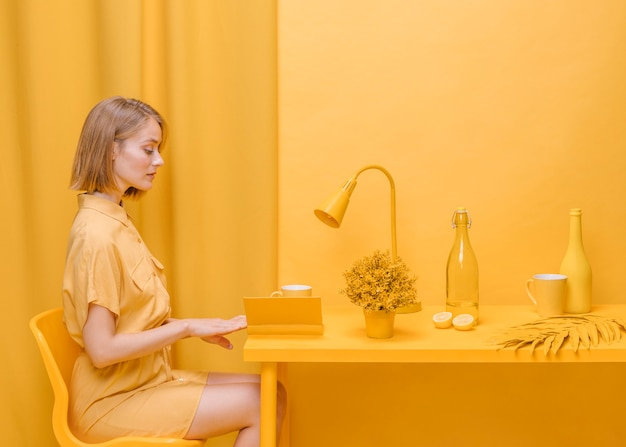 Woman reading book in yellow scene