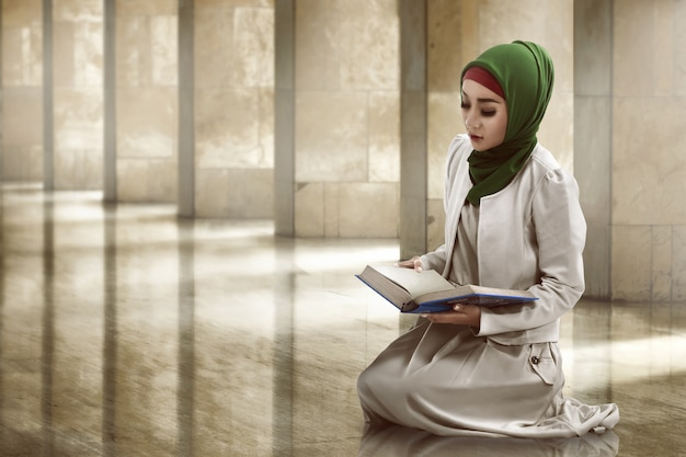 Woman reading koran