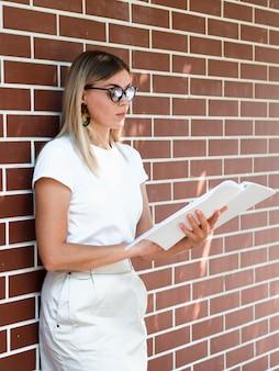 Woman reading a mock-up magazine