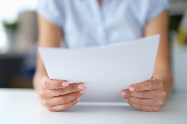 Woman reading notice of mortgage payments receiving email notification concept