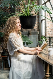 Woman reading a novel at a cafe