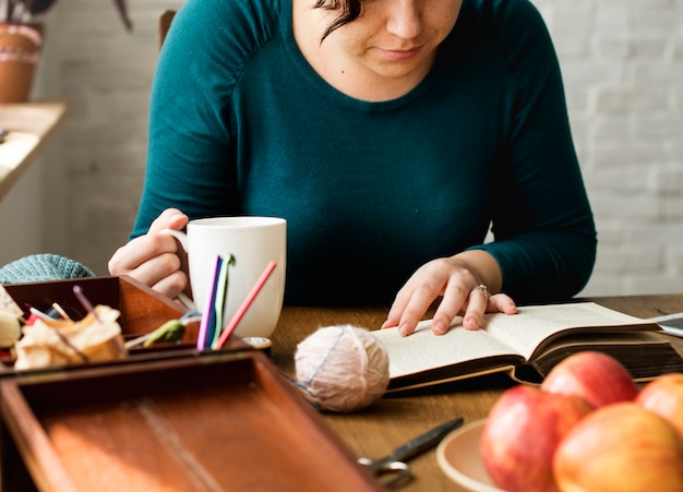 Woman reading relax drinking eating breakfast