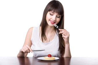 Woman ready to eat a cake