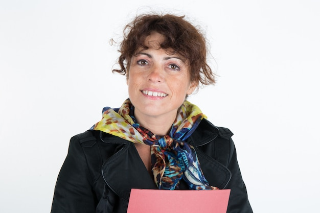 Woman real estate agentwith a coat and folders